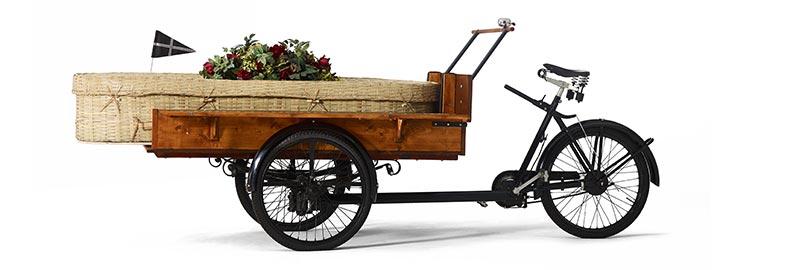 De rouwbakfiets. Duurzaam en milieuvriendelijk rouwvervoer voor een rouwstoet per fiets.